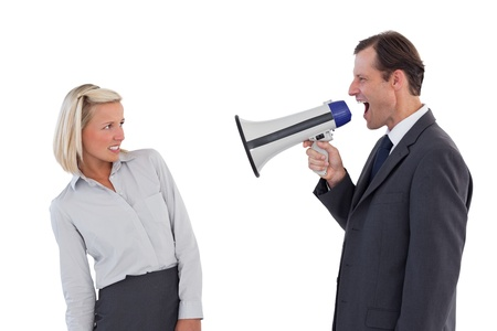 Businessman shouting at colleague with his megaphone on white background photo