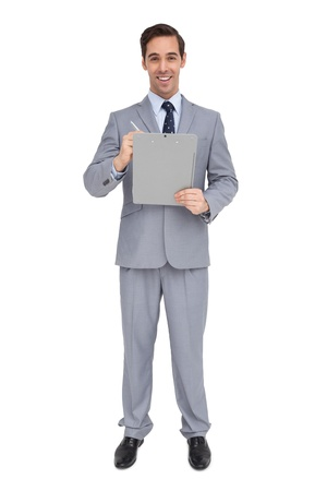 Happy businessman holding a clipboard on white background photo