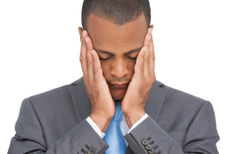Stressed businessman holding her head between hands on white background photo