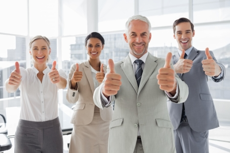 thumbs up business: Business people giving thumbs up in the meeting room Stock Photo
