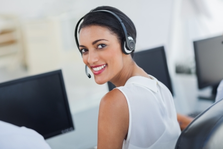 call: Call centre agent looking over shoulder with her headset
