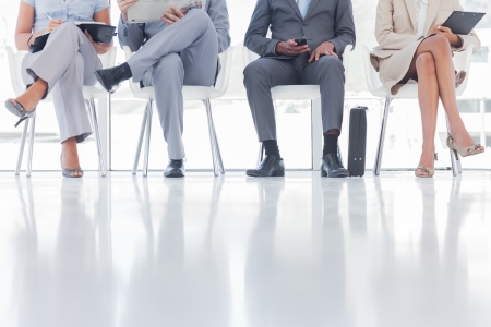 Group of business people waiting together in a waiting room photo