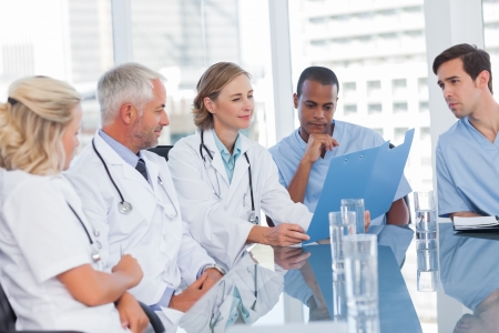 Medical team looking at a file in office