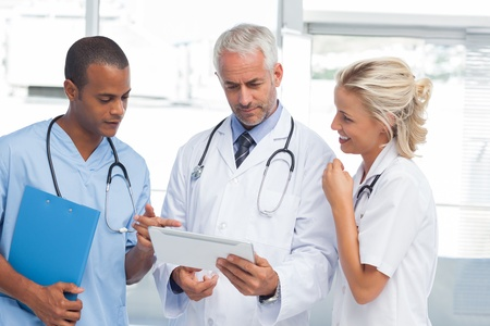Doctors using a tablet in hospital Stock Photo - 20501369