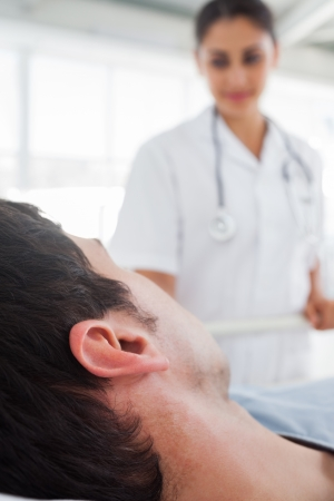 Close up on the head of a patient looking to his nurse photo