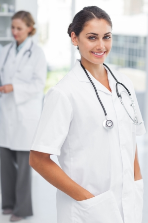 Attractive woman doctor putting her hand in her pockets photo