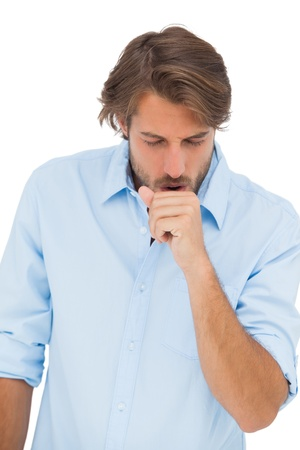 coughing: Tanned man coughing on white background Stock Photo