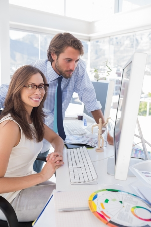 Creative team working at desk in bright modern office Stock Photo - 20516892