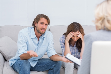 Couple arguing and crying on the couch during therapy session Stock Photo - 20500945