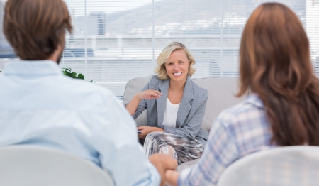 Psychologist speaking to a couple during a session photo