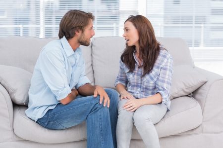 mid adult couple: Young couple quarelling in the office of therapist Stock Photo