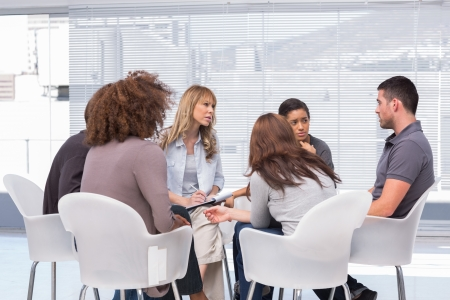psychotherapy: Patients telling their problems to therapist during session Stock Photo