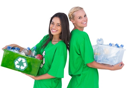 activists: Enivromental activists holding box of recyclables and standing back to back happily on white background Stock Photo