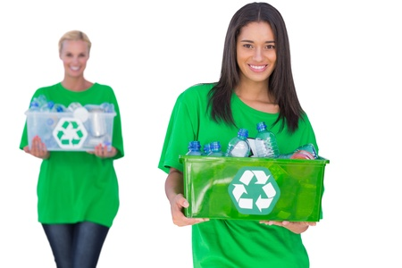 activists: Two enivromental activists holding box of recyclables on white background