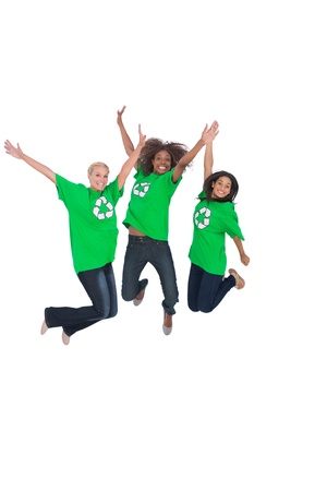 enviromental: Three enviromental activists jumping and smiling on white background Stock Photo