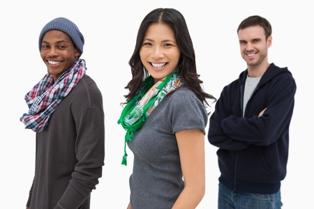casual hooded top: Happy stylish young people in a row  on white background