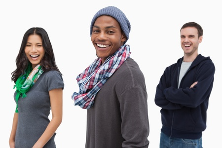 Laughing stylish young people in a row on white background photo