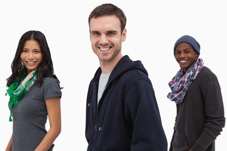 casual hooded top: J�venes con estilo felices en una l�nea en el fondo blanco