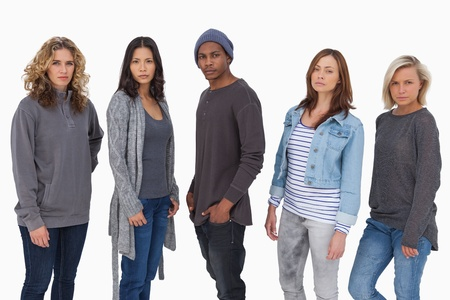 Fashionable young people in a line on white background photo