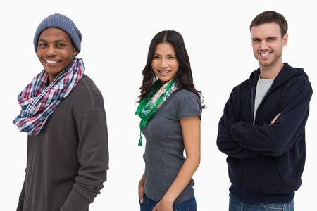 casual hooded top: Stylish young people in a row looking happy on white background