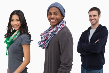 casual hooded top: Smiling stylish young people in a row on white background Stock Photo
