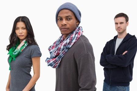 casual hooded top: Unsmiling stylish young people in a row  on white background Stock Photo