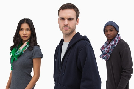 casual hooded top: Serious stylish young people in a line on white background Stock Photo