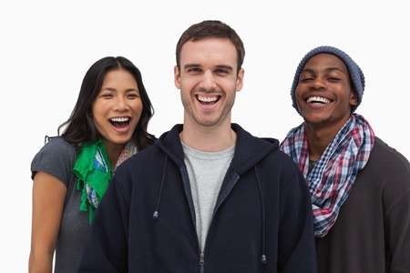 casual hooded top: Stylish young friends laughing at camera on white background