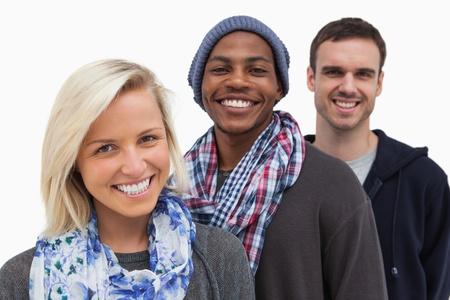 casual hooded top: Tres amigos de moda mirando a la c�mara y sonriendo sobre fondo blanco Foto de archivo