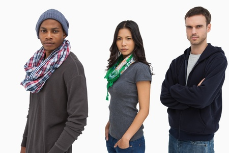 casual hooded top: Stylish young people in a row looking serious on white background