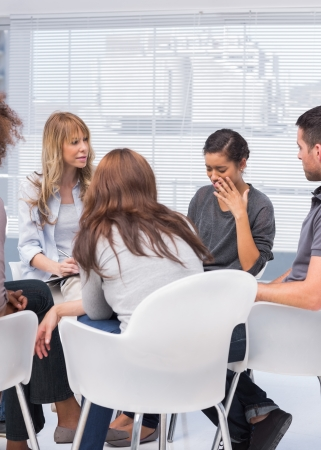 mental health: Patients and therapist listening to woman telling her problems