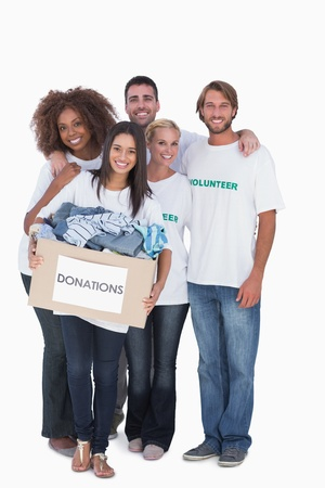 volunteer: Happy group of volunteers holding donation box on white background