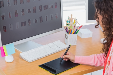 graphics tablet: Editor using graphics tablet to edit at her desk