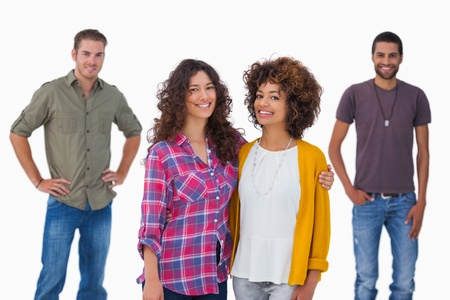 Fashionable young friends smiling at camerayoung  on white background photo