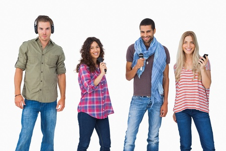 Friends using various types of technology on white background photo