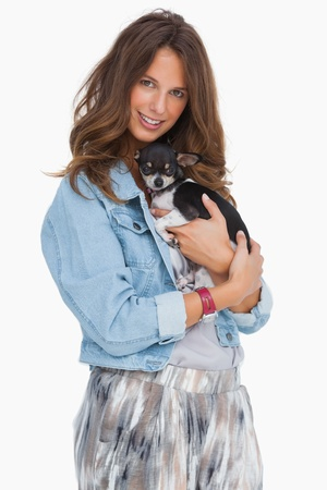 Pretty woman with her puppy on white background Stock Photo - 20501487