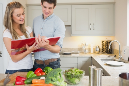 Couple reading cookbook together photo