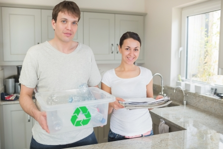 Couple recycling in kitchen photo