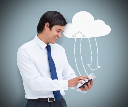 Businessman holding a tablet pc connecting with cloud computing symbol on  photo