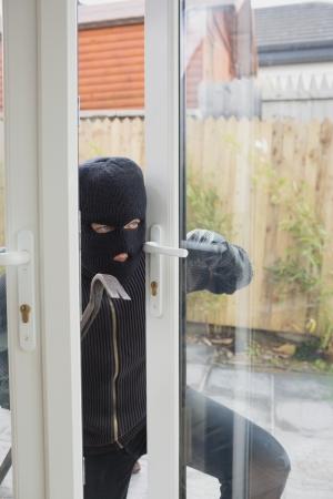 backdoor: Burglar opening the terrace door with cro bar