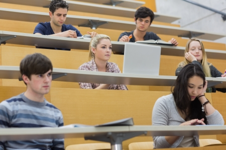 Students listening in a lecture hall  in college and taking notes Stock fotó