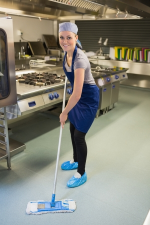 clean food: Woman cleaning the kitchen in the restaurant