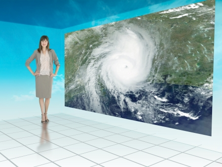 Businesswoman standing next to futuristic screen showing weather on a satellite map Stock Photo - 20493647