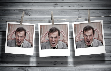 peg board: Three instant photos of an angry businessman hung with pegs with wooden boards on the background Stock Photo