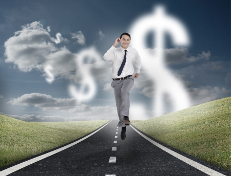 Dollar currency behind businessman running on a road with cloudy sky on the background photo