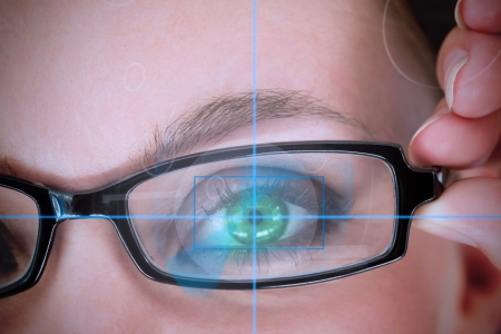 identifying: Woman with green eyes analyzing something with a target line Stock Photo