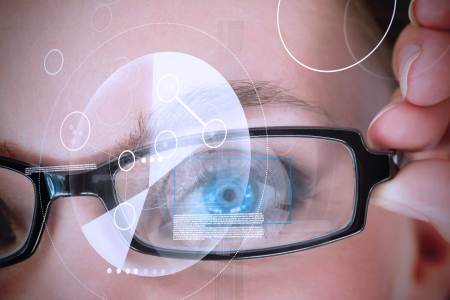 futuristic woman: Womans eye with glasses being scanned for authorization Stock Photo