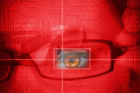 analysed: Woman having an eye analysed with red circuit board on the background Stock Photo