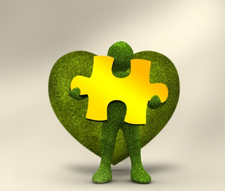 Green character holding a yellow jigsaw in front of a green heart photo