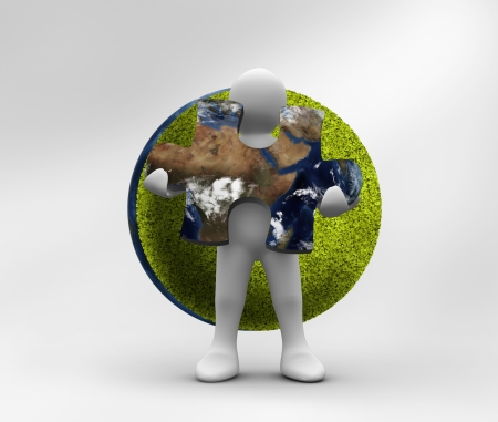 Human form holding a jigsaw puzzle with part of the world inside with green planet on the background photo